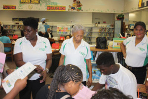 Links members: Karen Moreland Alford, Sadie Smith and Janice Hayes with students at Annabel C. Perry Elementary; background - Broward UNA Members: Major Diljit Pannu, NGO Chair and Frantz Jerome, Model UN Chair.