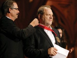 Film producer Harvey Weinstein, right, is presented with the W.E.B. Du Bois medal by Glenn Hutchins during ceremonies Tuesday, Sept. 30, 2014, on the campus of Harvard University, in Cambridge, Mass. The Du Bois Medal is Harvard's highest honor in the field of African and African American Studies. (AP Photo/Steven Senne)