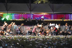 People dive for cover at the Route 91 Harvest County Music Festival after apparent gunfire was heard on October 1, 2017 in Las Vegas Nevada (Photo credit: gettyimages.com)
