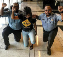 Two Black Chicago cops reprimanded for taking a knee with raised fist