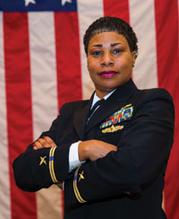Chief Warrant Officer (CWO) 5 Valencia Simmons-Fowler was promoted as the first African-American CWO 5 in the information warfare community on November 3rd. The CWO rank is a technical specialist who performs duties that directly related to their previous rating. They are accessed from the chief petty officer pay grades E-7 to E-9, and must have a minimum of 14 years of service. (U.S. Navy photo by Petty Officer 3rd Class Kyle Hafer/Released)