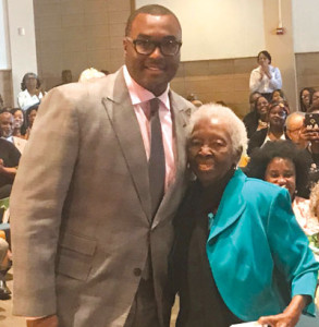 Pastor Marcus Davidson and Luereen Flournoy, who has been a member for 68 years.