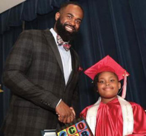 Principal Royston Maxwell Lyttle with one of his stu-dents.                                    (Photo courtesy Royston Lyttle)  By Royston Maxwell Lyttle