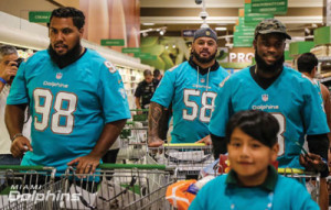 Gabe Wright (98), Rey Maualuga (58) and Malcom Lewis (18) at Publix Kids and Fins Shopping Spree.       Photo credit Miami Dolphins
