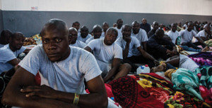 Nigerian migrants inside a locked hangar at the Airport Road detention center in Tripoli, where they had been held for more than a month.