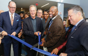 L to r:  Pompano Beach Mayor Lamar Fisher, Broward County Mayor Beam Furr, Broward County Libraries Director Kelvin Watson, and Broward County Commissioner Chip LaMarca cut the ribbon at the new Pompano Beach City Library and Cultural Center.