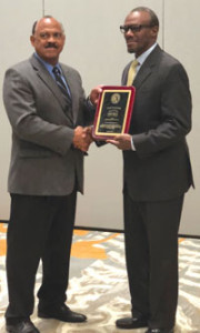 Ron Coleman (left), chairman of the Hall of Fame committee presents Phillip Rolle with his Hall of Fame plaque.