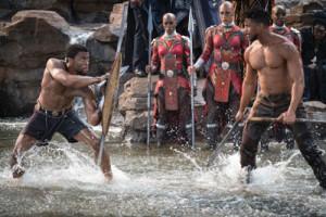 T'Challa/Black Panther (Chadwick Boseman) and Erik Killmonger (Michael B. Jordan) Fight as the Dora Milaje look on. (Photo credit: Matt Kennedy..©Marvel Studios 2018)
