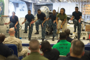 GULF OF ADEN — Sailors and a Marine perform a step dance during the African American and Black History Month celebration aboard the amphibious assault ship USS Makin Island (LHD 8). The ship is deployed in the U.S. 5th Fleet area of operations in support of maritime security operations designed to reassure allies and partners, and preserve the freedom of navigation and the free flow of commerce in the region. (U.S. Navy photo by Mass Communication Specialist 3rd Class Devin M. Langer)