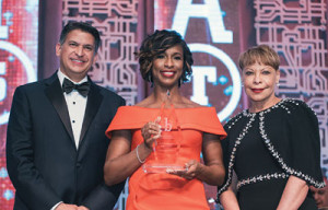 Jose Tomas, the senior vice president of global human resources and the executive vice president for Lockheed Martin (Ret.) (L) and Linda Gooden from the General Motors Board of Directors (R) present Alicia Boler Davis, the executive vice president global manufacturing for General Motors with the 2018 Black Engineer of the Year Award. (General Motors)