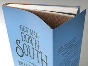 """Mock-ups of New Man Down South, a 284 page, leather-bound hardcover book, 7"""" x 9"""" uniquely designed to be an aesthetically beautiful """"autobiographical archive."""""""