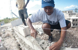 Ivon Alcime, a graduate communications major, helps build a cement wall at the School of Good Samaritans as part of a previous Alternative Spring Break in Haiti after the country was struck by an earthquake that devastated much of the island. (Justin D. Knight/Howard University)