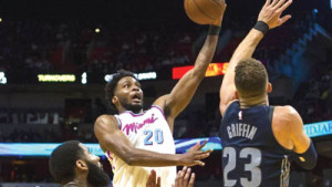 Winslow scoring over Blake Griffin of the Pistons.