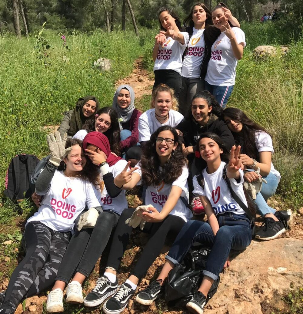 Arab and Jewish girls volunteered together to clear debris from a forest on Good Deeds Day in Israel. Photo courtesy of A New Way